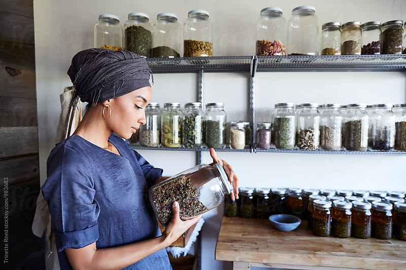 Millennial African American Woman Maker in Her Studio Looking at ingredients by Trinette Reed for Stocksy United