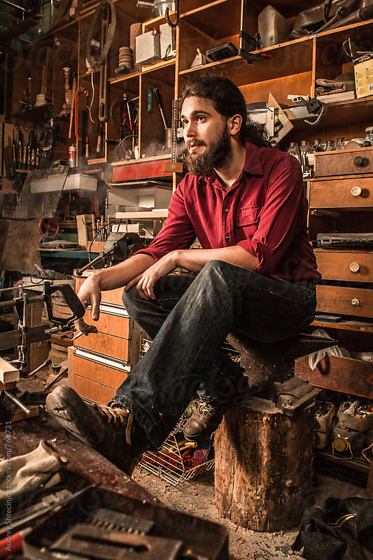Portrait of young carpenter in his rustic workshop. by Audrey Shtecinjo for Stocksy United
