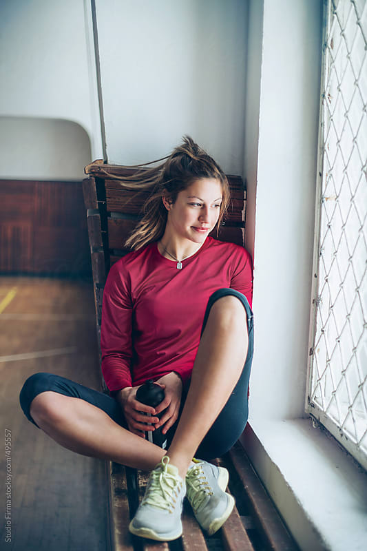 Young woman in the gym. by Studio Firma for Stocksy United