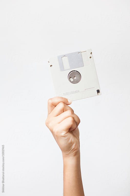 Hand with a diskette.  by Shikhar Bhattarai for Stocksy United