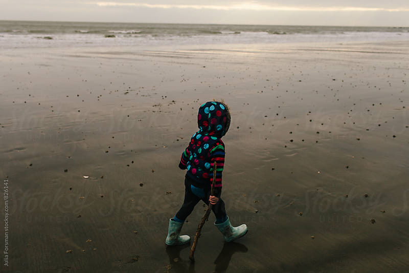 Little girl walking on a deserted beach in the morning. by Julia Forsman for Stocksy United
