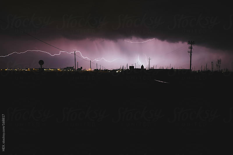 City Skyline with Storm and Lightning  by HEX. for Stocksy United