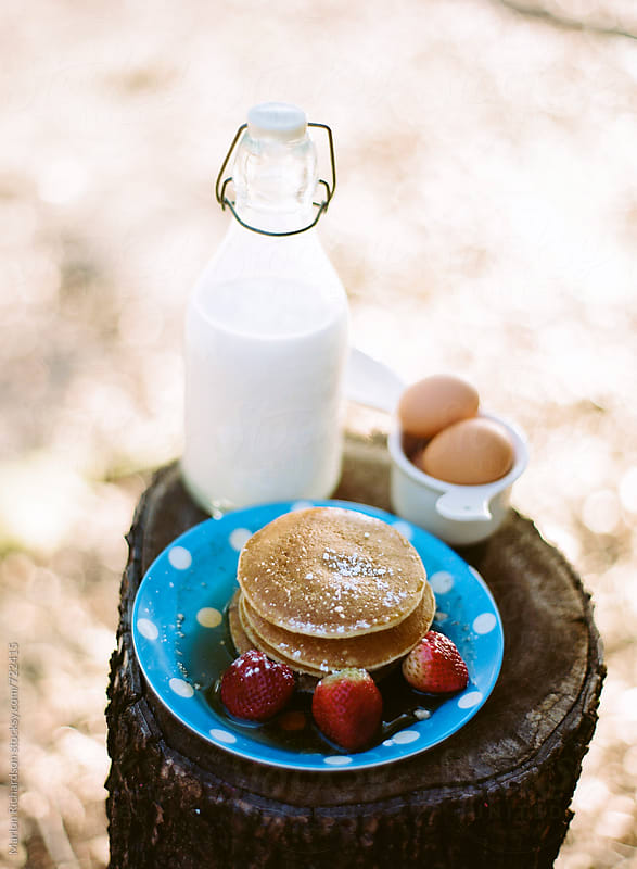 Pancakes, milk eggs, and strawberries by Marlon Richardson for Stocksy United