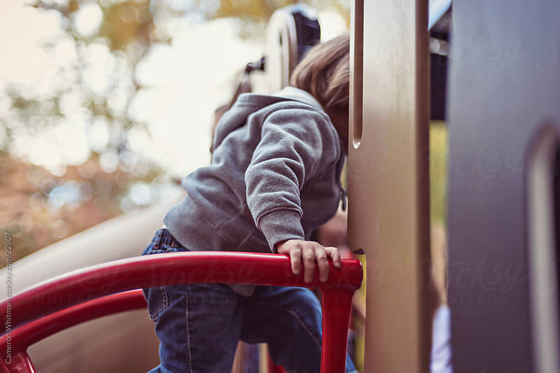 Little Boy Climbing Around Playground Structure by Cameron Whitman for Stocksy United