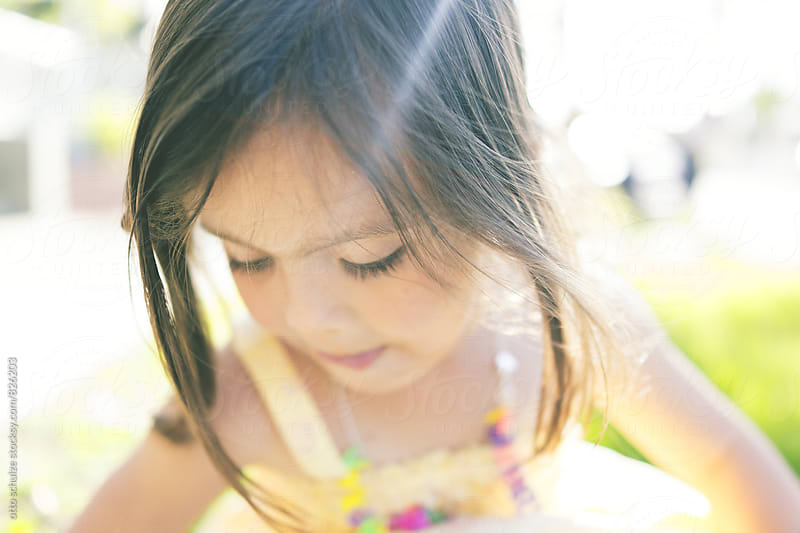 CLose up of a little girl by otto schulze for Stocksy United