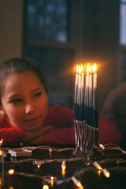 Hanukkah: Looking At Candles On Eight Night Of Hanukkah by Sean Locke for Stocksy United