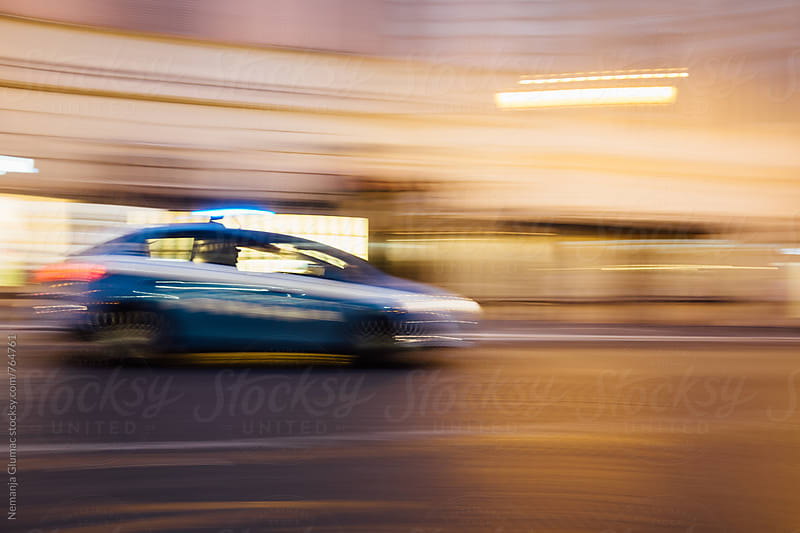 Police Car in High Speed Chase by Nemanja Glumac for Stocksy United