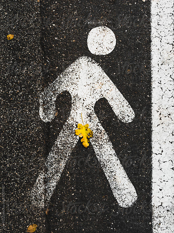 sign of a naked pedestrian with a fig leaf by Juri Pozzi for Stocksy United