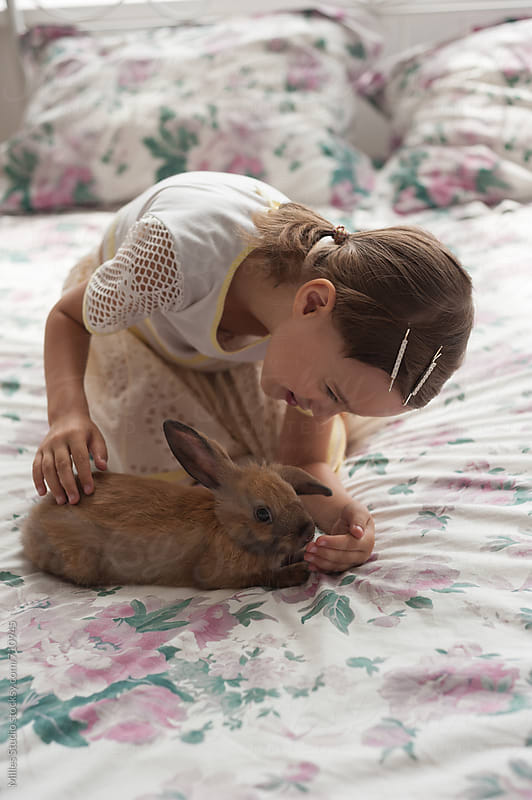 Girl with rabbit by Milles Studio for Stocksy United
