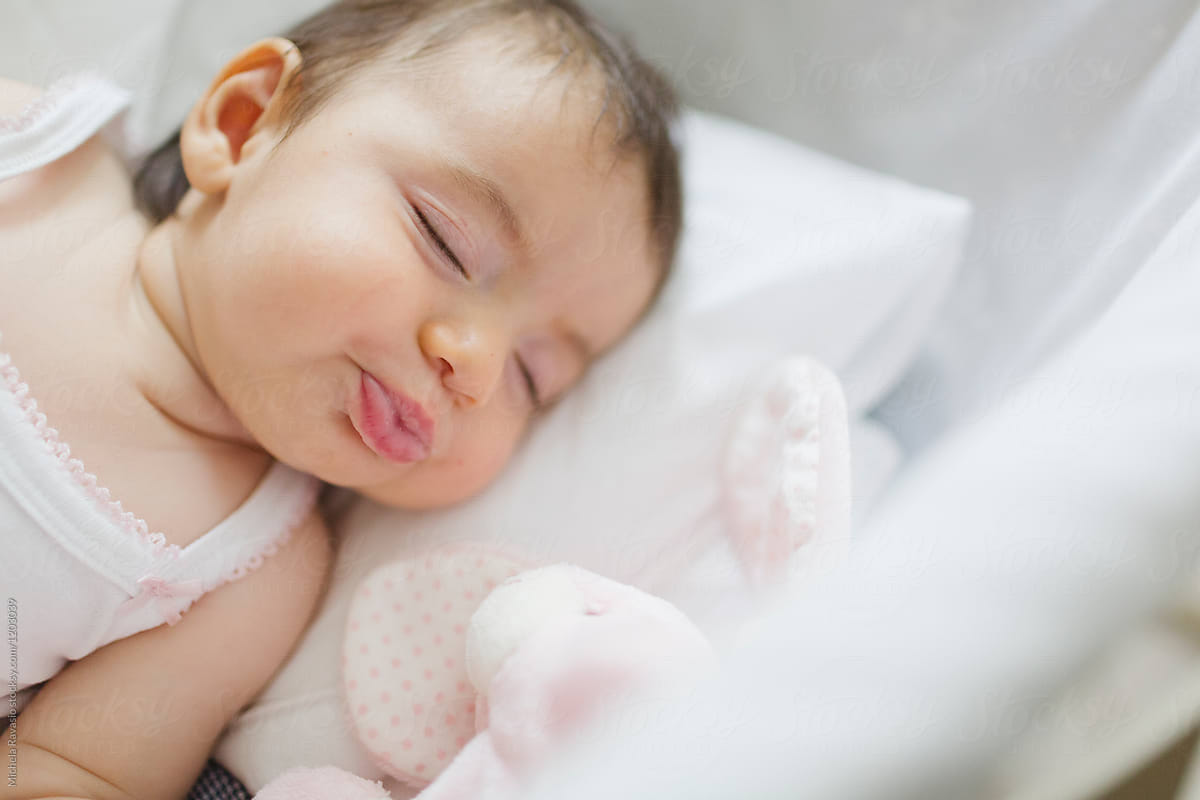 Funny Baby Girl Sleeping In The Cradle By Michela Ravasio Stocksy United