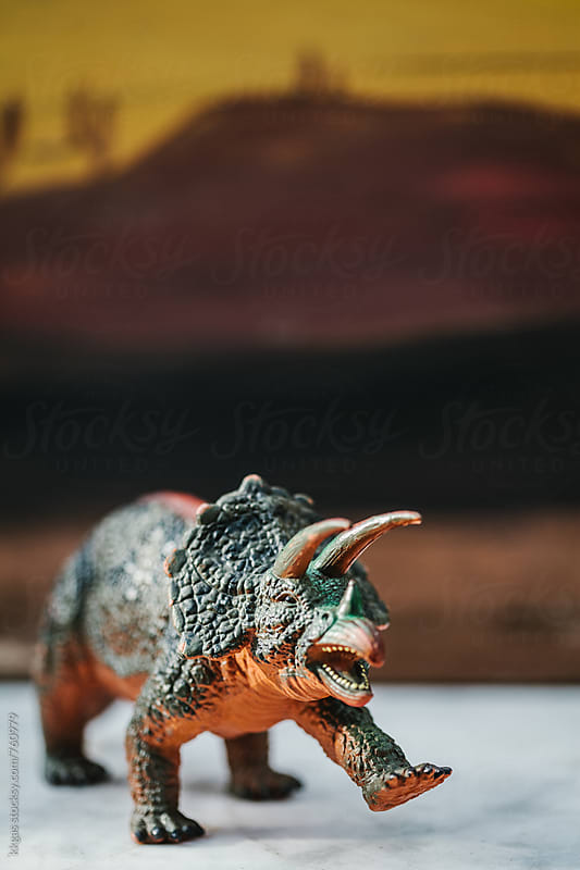 Toy dinosaur in front of painted background by kkgas for Stocksy United