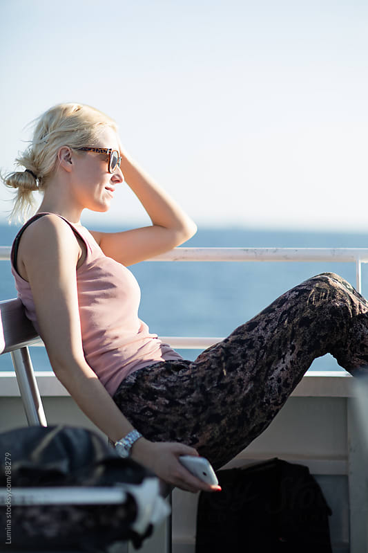 Woman on a Ferryboat by Lumina for Stocksy United