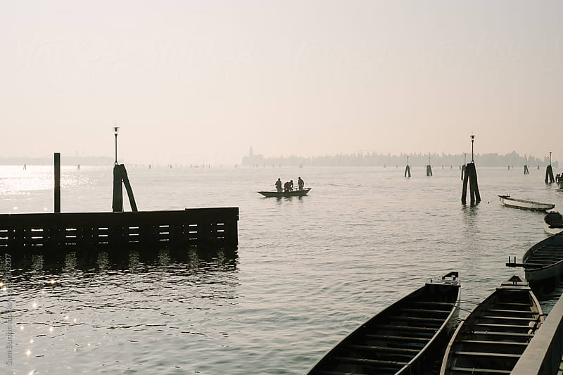 Men in a boat in Venice by Sam Burton for Stocksy United