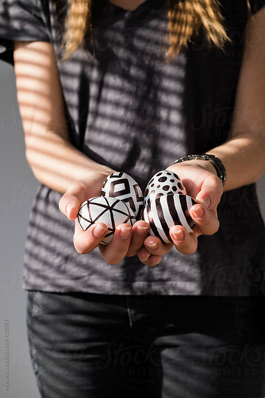 Woman Holding Black and White Easter Eggs by Mosuno for Stocksy United