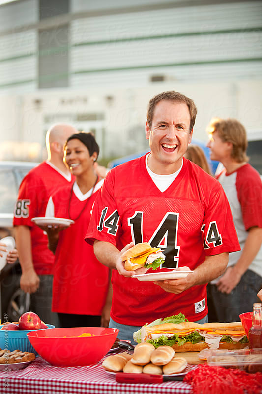 Tailgating: Man Having Great Time at Tailgate Party by Sean Locke for Stocksy United