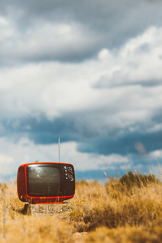 old TV in the dry field by Javier Pardina for Stocksy United