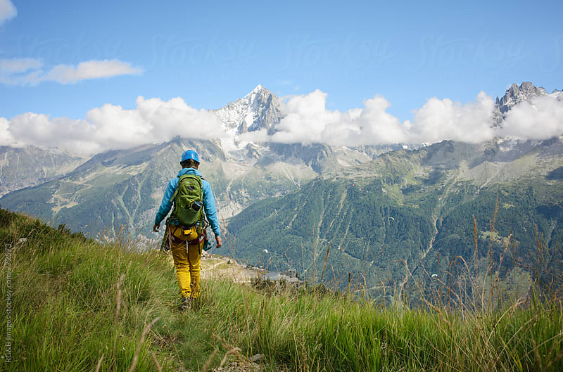 Woman wearing mountain equipment hiking in the Alps by RG&B Images for Stocksy United