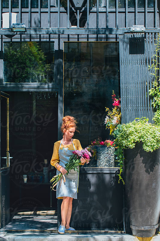 Ginger-Haired Florist Holding a Flower Bouquet by Lumina for Stocksy United