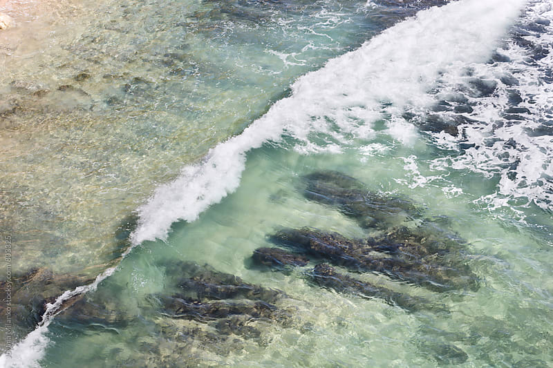 Abstract aerial view of tidal waves reaching the shore  by Jovana Milanko for Stocksy United