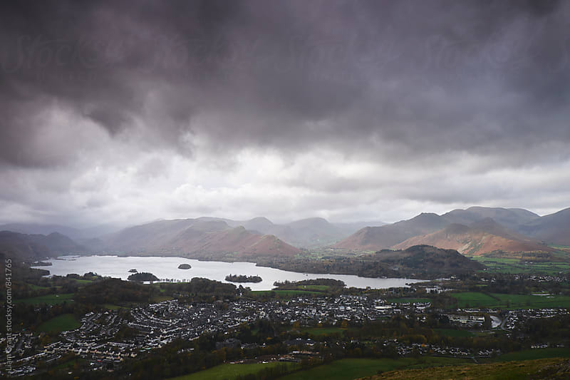 Rain clouds over Derwent Water and Keswick. Cumbria, UK. by Liam Grant for Stocksy United