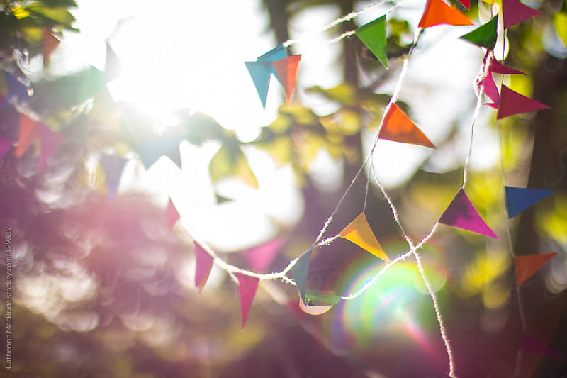 Bunting, bokeh and sunshine... by Catherine MacBride for Stocksy United