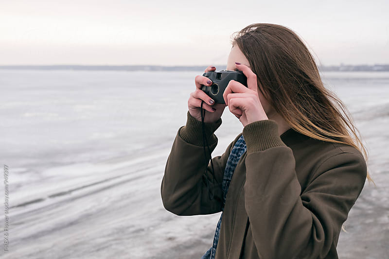 Long-haired girl taking shot with old camera by Danil Nevsky for Stocksy United