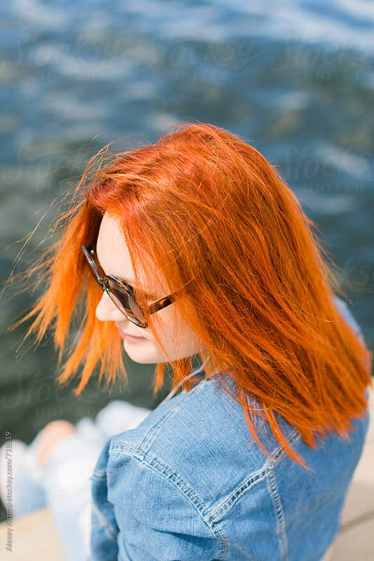 portrait of  happy girl  with round sunglasses and red hair by Alexey Kuzma for Stocksy United