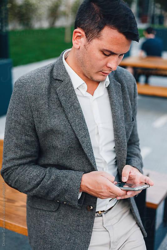 Businessman in the city by Dimitrije Tanaskovic for Stocksy United