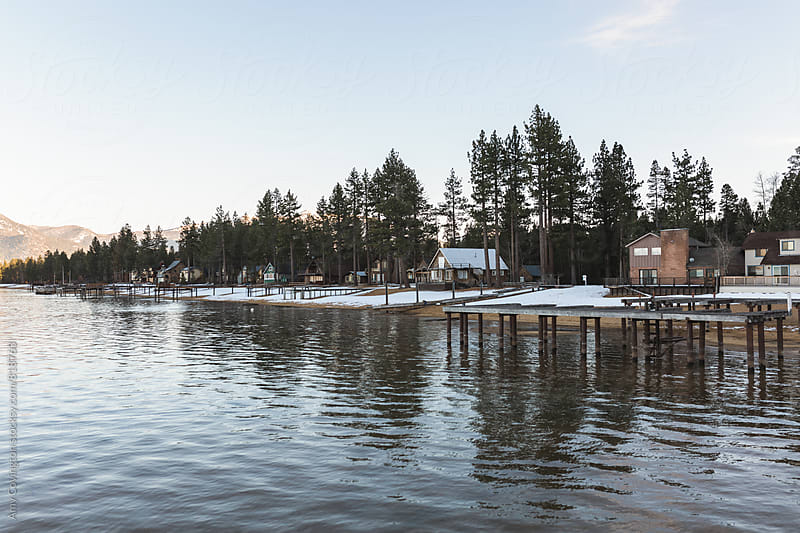 Lake front homes at winter time by Amy Covington for Stocksy United