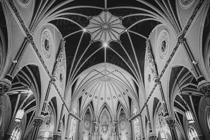 Greyscale Interior of Ornate Catholic Church Sanctuary by Alicia Magnuson Photography for Stocksy United