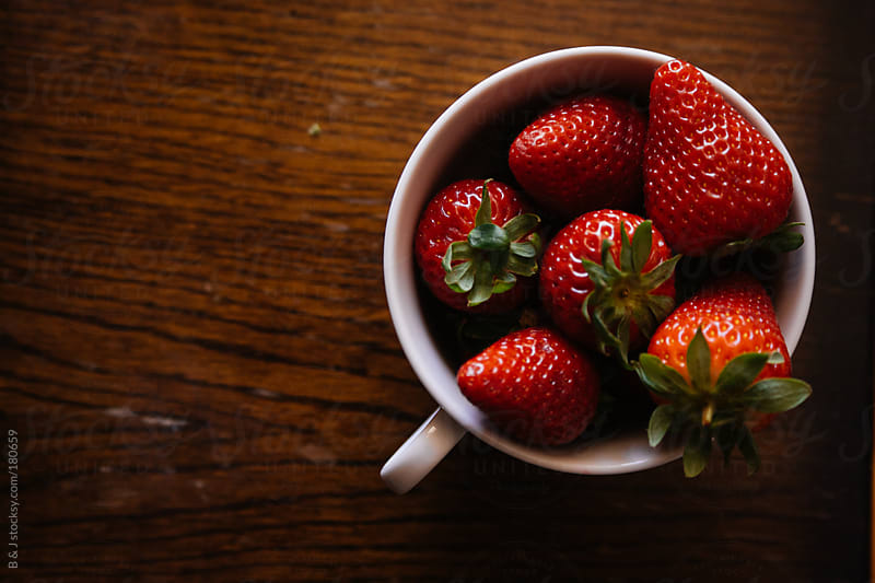 Strawberries in a cup by B & J for Stocksy United