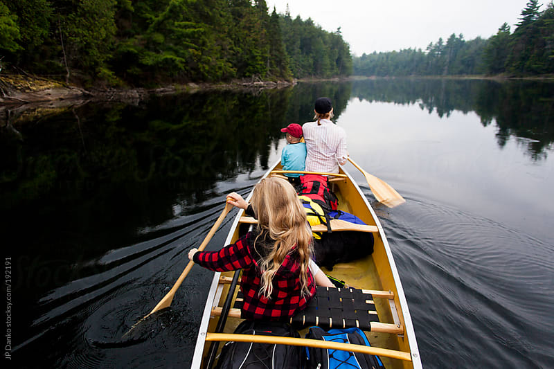 Family Relaxing On Quiet Lake Wilderness Camping Trip in Canoe by JP Danko for Stocksy United