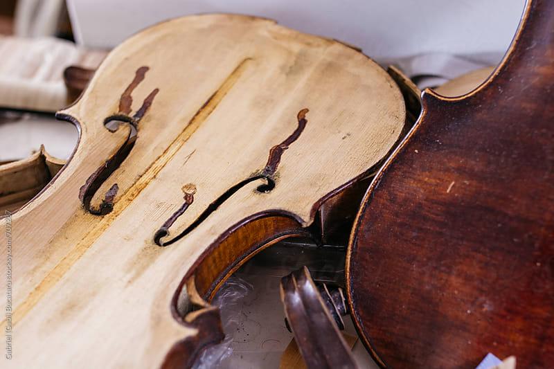 Violin body being worked on by Gabriel (Gabi) Bucataru for Stocksy United