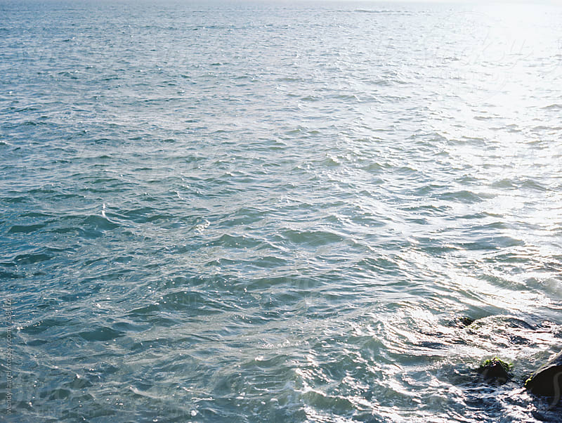 blue ocean with sunshine on film by wendy laurel for Stocksy United