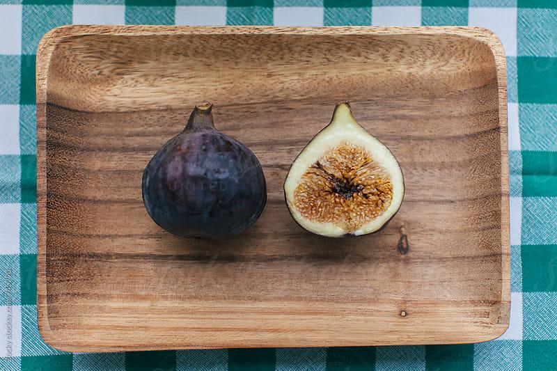 Cut fresh fig by Zocky for Stocksy United