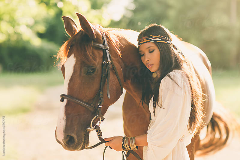Asian Woman Hugging Her Horse by Lumina for Stocksy United