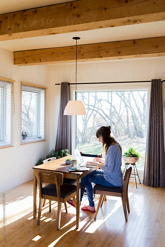 Woman working from modern home office by Carey Shaw for Stocksy United