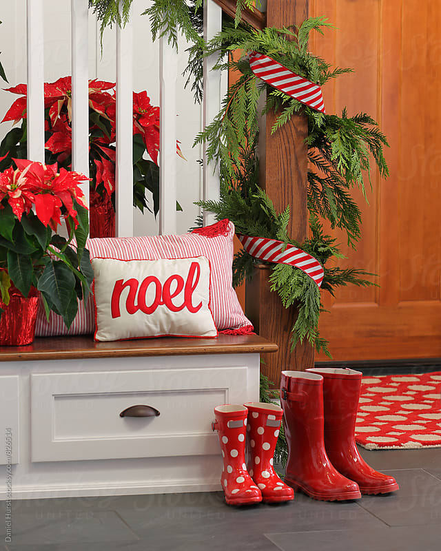 Boots in home entry decorated for Christmas by Daniel Hurst for Stocksy United
