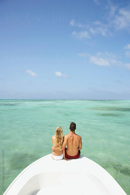 Couple relaxing on vacation on a boat in the Caribbean  by Trinette Reed for Stocksy United