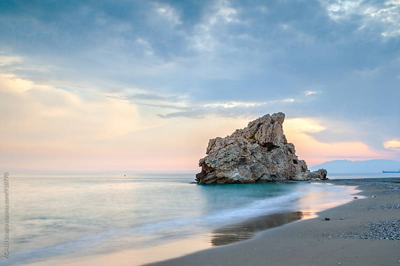 Crag in the beach at sunset by ACALU Studio for Stocksy United
