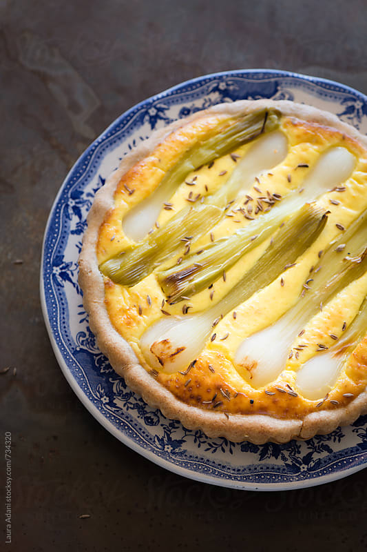 quiche stuffed with ricotta and green onions by Laura Adani for Stocksy United