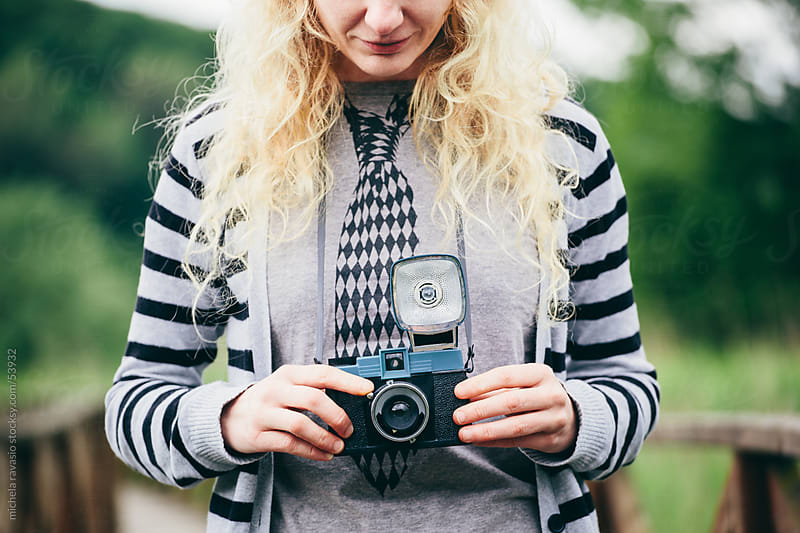 Woman with vintage camera by michela ravasio for Stocksy United