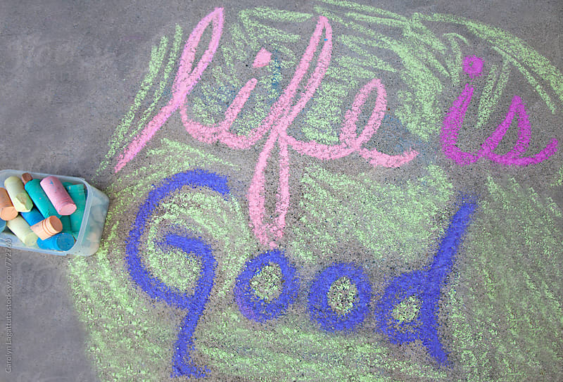 Life is good written in chalk on the ground by Carolyn Lagattuta for Stocksy United