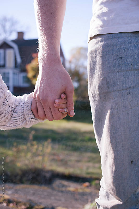father and daughter holding hands by Koen Meershoek for Stocksy United