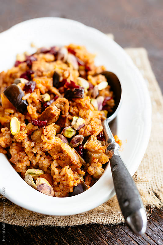 Eggplant Pilaff with Spicy Tofu Pieces, Cranberries and Pistachios by Harald Walker for Stocksy United