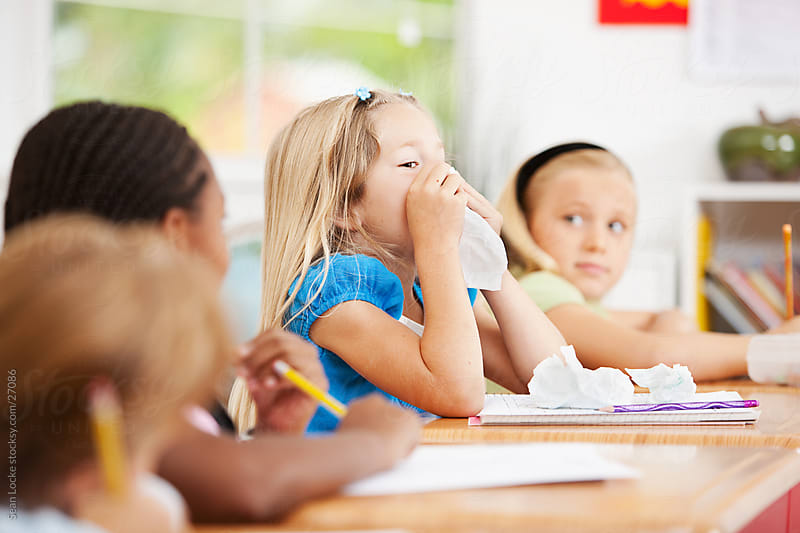 Classroom: Girl Sneezing in Class by Sean Locke for Stocksy United