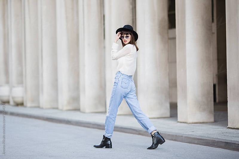 Fashionable young woman walking on the street by Jovana Rikalo for Stocksy United