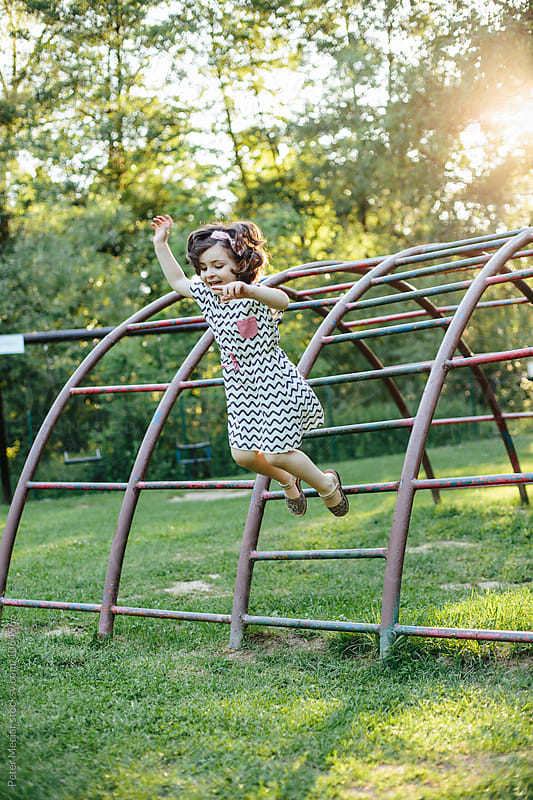Little Girl on the Playground by Peter Meciar for Stocksy United
