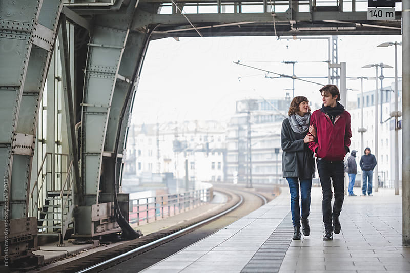 Couple in railway station by michela ravasio for Stocksy United