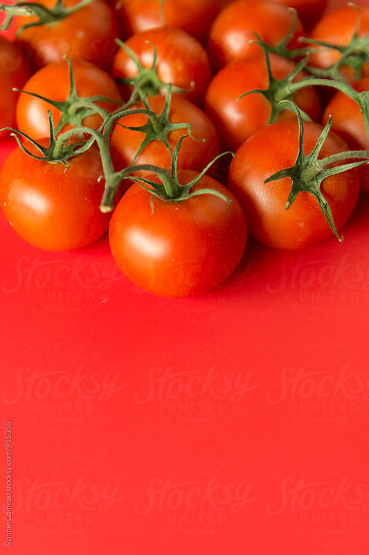 Juicy Red Tomatoes On Red by Ronnie Comeau for Stocksy United